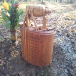 Brown oak memorial with carved tools.