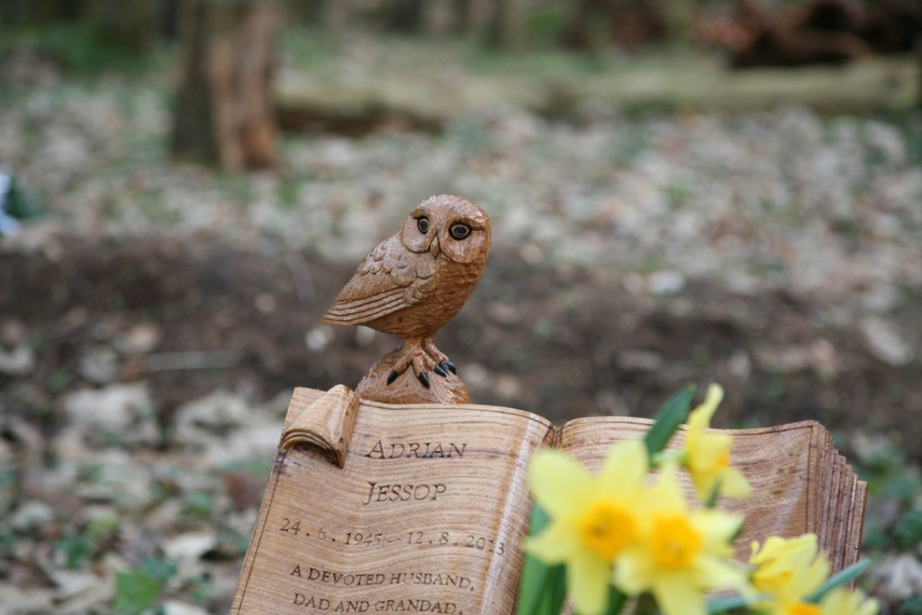 Carved book memorial with little owl.