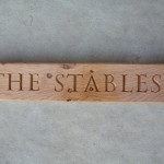 The Stables house sign