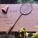 Badminton racket and shuttle cock.