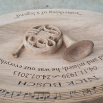 French Horn relief with musical notation pyrography