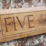Five, house sign.